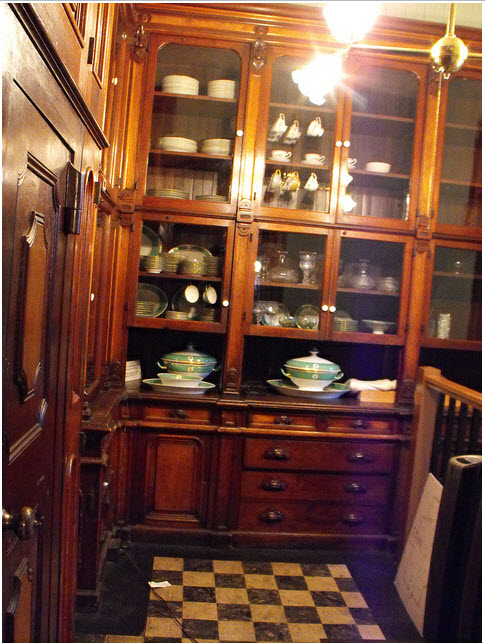 Handsome butlers pantry with ladder